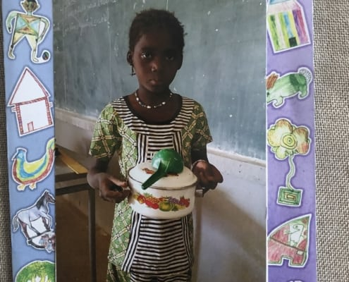 Aiche in Mali sent Aqua Plumbing & Air and Iconnectu a package today. She's 8 now and learning to cook!
